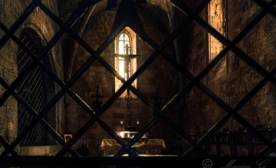 Monastery of Filerimos, parying, candles, jesus, stone walls, fence, canon