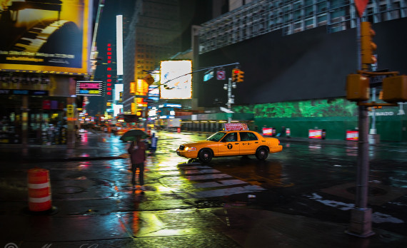Yellow cab, speeding, wet street, raining, empty street, canon